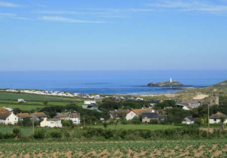 View of Gwithian Village and Godrevy